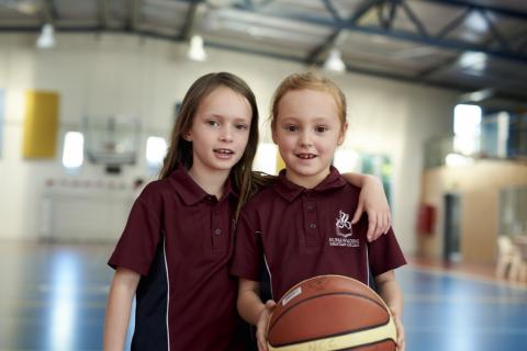 Melbourne Primary School students playing basketball