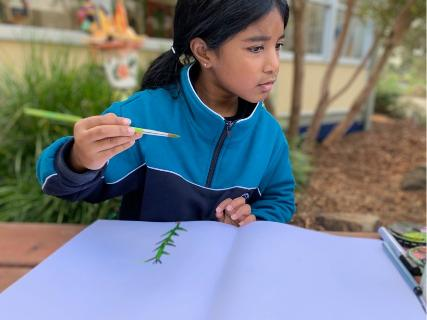 Year 1 student drawing outside